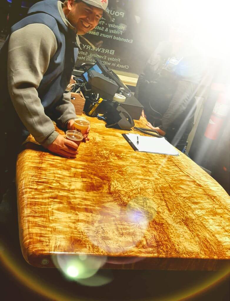 Live edge curly maple table at 2 silos brewery